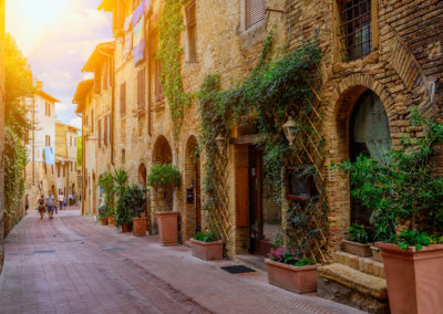 Old street in San Gimignano, Tuscany, Italy. San Gimignano is typical Tuscan medieval town in Italy-Florence and Tuscany