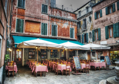 restaurant tables and chiairs in a small square-Venice Italy